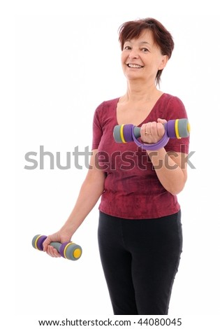 Smiling senior fitness woman with barbells - stock photo