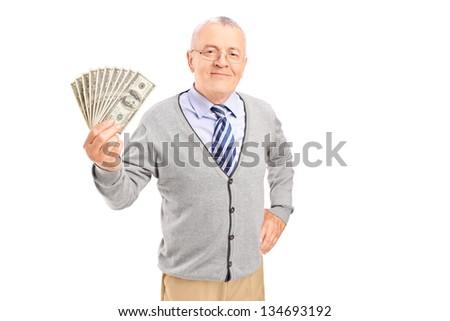 Smiling senior gentleman holding money, isolated on white background - stock photo