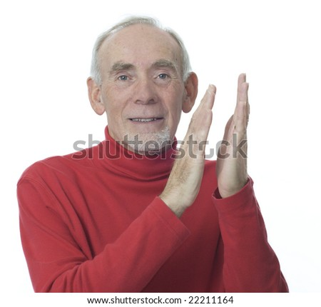 Smiling senior man clapping hands - stock photo