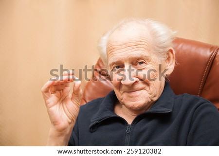 smiling senior man holding a tablet - stock photo