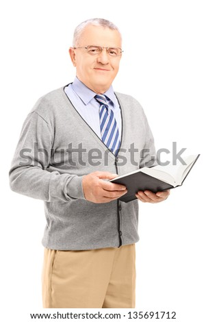 Smiling senior man reading a book, isolated on white background - stock photo