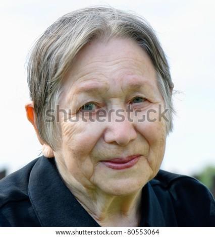 Smiling senior woman outdoor - stock photo