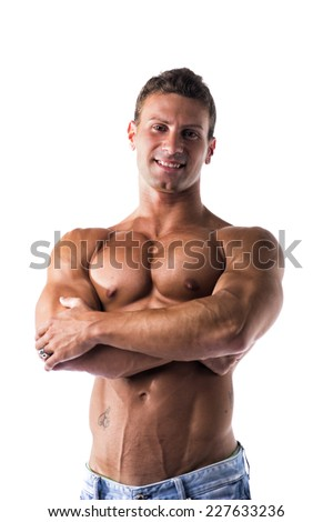 Smiling shirtless muscular young man standing with arms crossed on chest, looking at camera, isolated on white