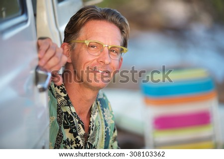 Smiling single middle aged Caucasian male outdoors - stock photo