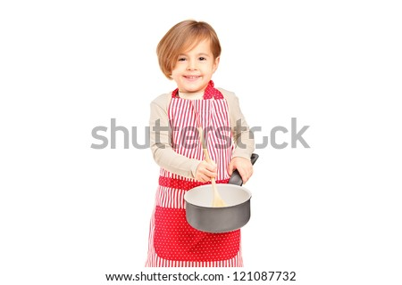 Smiling small girl holding a frying pan and kitchen utensil isolated on white background - stock photo