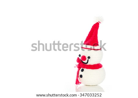 Smiling snowman wearing a bright red hat, red scarf. On a white background