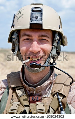 smiling soldier smoking a cigarette - stock photo