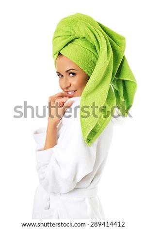 Smiling spa woman in bathrobe. - stock photo