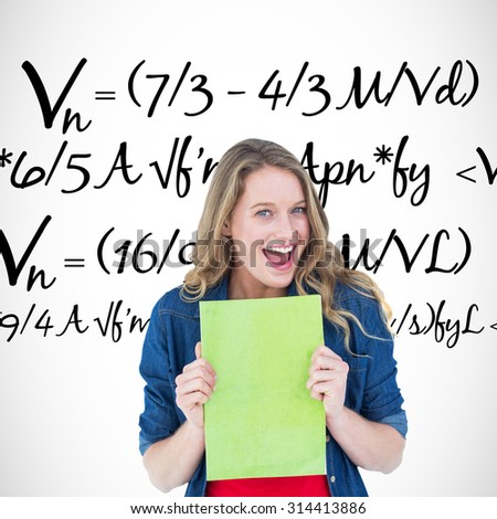Smiling student holding notebook against maths equation - stock photo