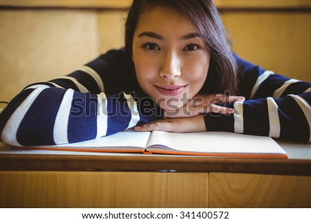 Smiling student in lecture hall at the university