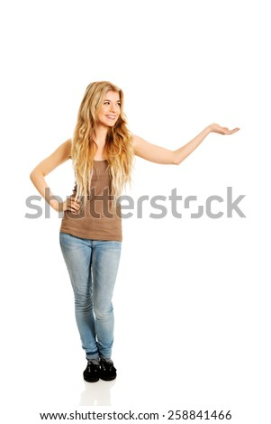 Smiling student woman holding copyspace. - stock photo