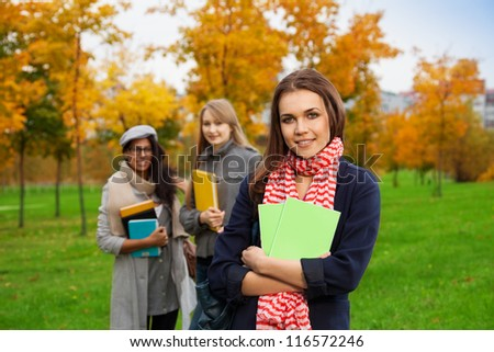 smiling students standing in park - stock photo
