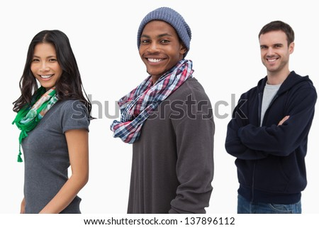 Smiling stylish young people in a row on white background - stock photo