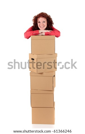 Smiling successful businesswoman standing behind a stack of storage boxes. Studio shot. White background