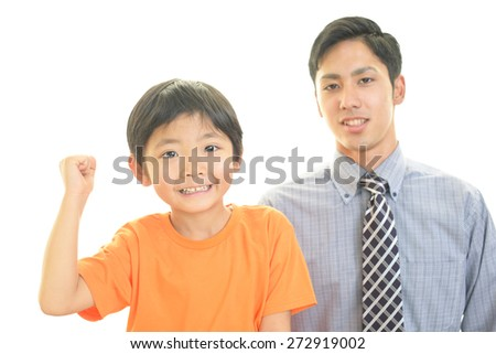 Smiling teacher with little boy - stock photo