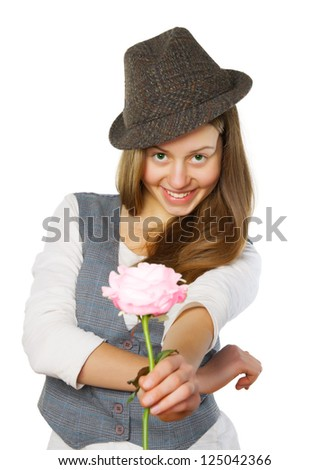Smiling teen girl in hat giving a rose. Isolated on white