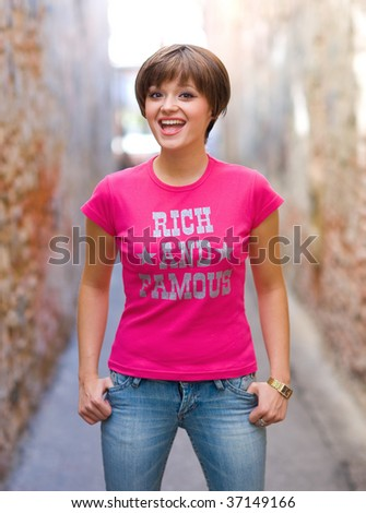 smiling teen girl on the street - stock photo