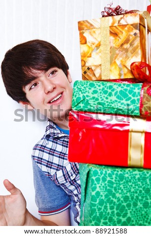Smiling teen happy to receive presents