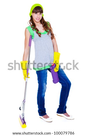 Smiling teen with detergent and mop - stock photo