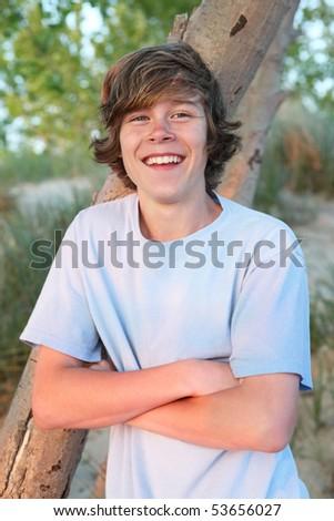 Smiling teenage boy - stock photo