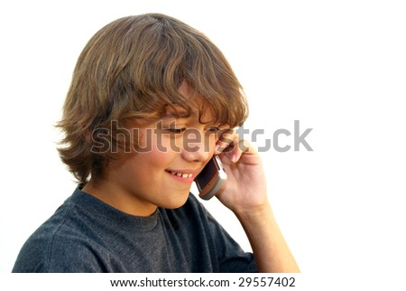 Smiling teenage boy talking on mobile phone isolated on white background.