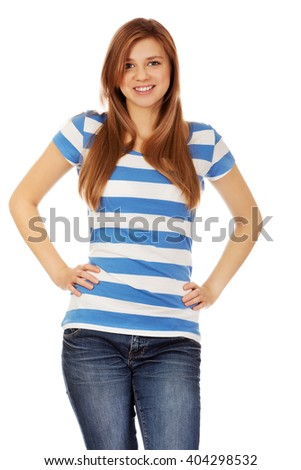 Smiling teenage woman with hands on hips - stock photo