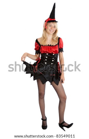 smiling teenager girl in Halloween witch - stock photo