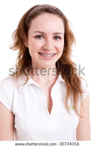 Smiling teenager wearing braces - stock photo