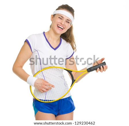 Smiling tennis player playing on racket as on guitar - stock photo