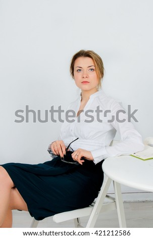 Smiling therapist taking notes on white background. Portrait of a friendly woman being ready to take notes - stock photo