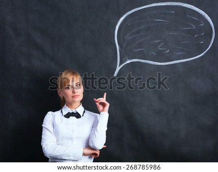 Smiling thinking girl looking up with empty bubble  - stock photo