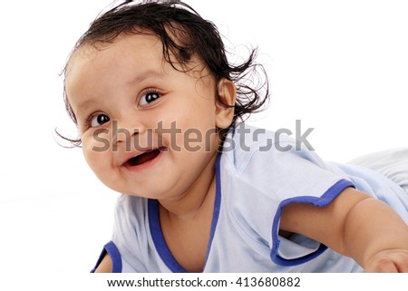 Smiling toddler against white background  - stock photo