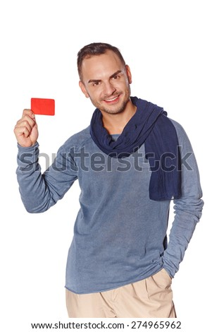 Smiling trendy casual man showing blank credit card over white background