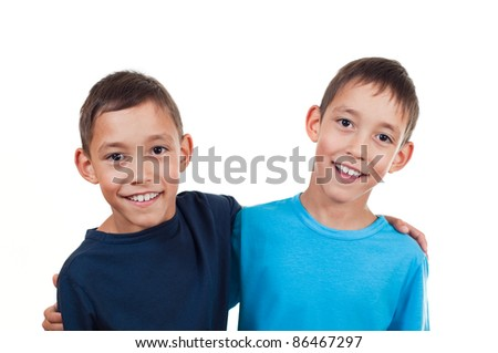 smiling twins isolated on white background happy together