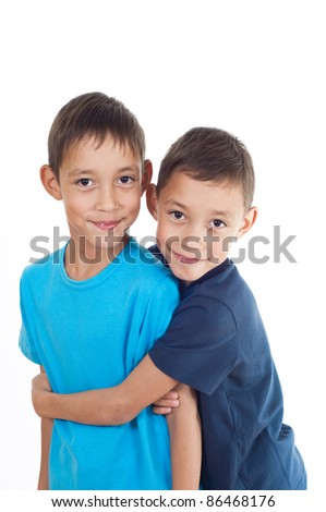 smiling twins isolated on white background happy together - stock photo