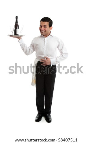 Smiling waiter, butler, bartender ot other attendant holding a silver tray with a bottle or wine and glasses.  White background. - stock photo