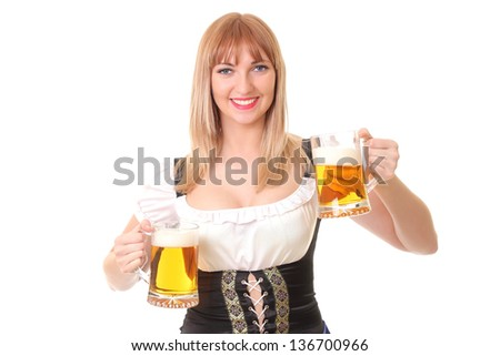 smiling waitress with two mugs of beer - stock photo