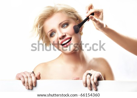 Smiling woman and brush - stock photo