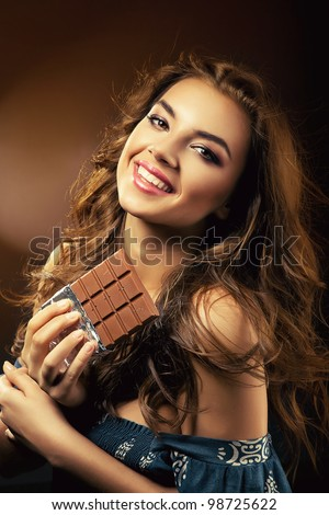 smiling woman and chocolate bar - stock photo