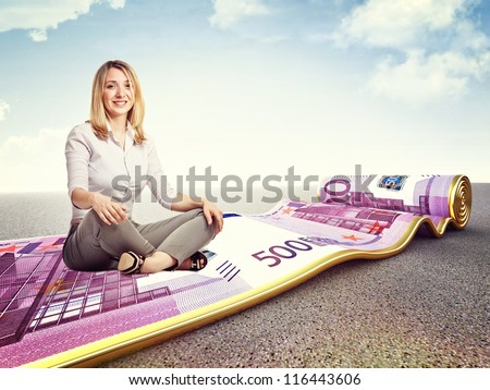 smiling woman and 3d image of rolling euro carpet - stock photo