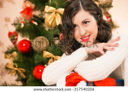 smiling woman at christmas tree background
