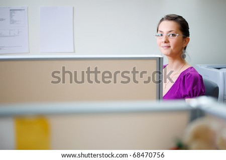Smiling woman at office in casual clothes - stock photo