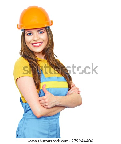 Smiling woman builder show thumb, helmet dressed. Woman in coverall uniform. - stock photo