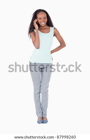 Smiling woman calling on a white background
