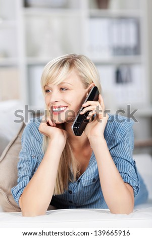 Smiling woman calling using her cellular phone