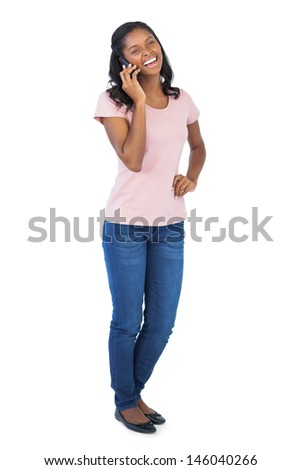 Smiling woman calling with her mobile phone on white background - stock photo