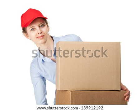 Smiling woman carrying big boxes, on white background - stock photo