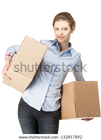 Smiling woman carrying two big boxes, isolated on white - stock photo