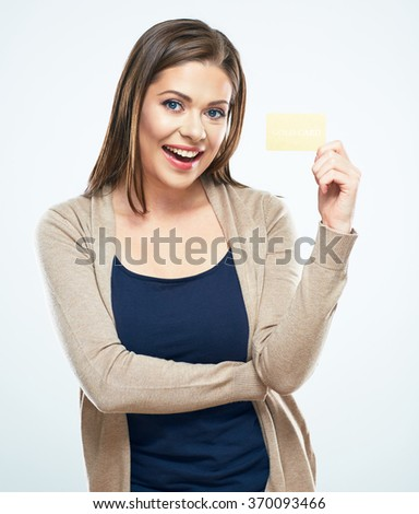 Smiling woman casual style dressed holding credit card. White background isolated portrait. - stock photo