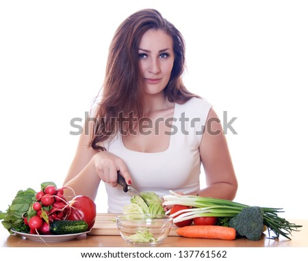 Smiling woman cooking healthy food isolated - stock photo